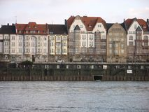 Townhouses at a river. Townhouses in the historic city of Düsseldorf, Germany Stock Photos