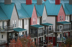 Townhouses. Row of townhouses with a green, tin roof Stock Photo
