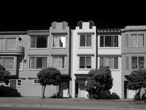 Townhouses in San Francisco. A black and white view of the side or exterior of several townhouses in San Francisco Stock Images