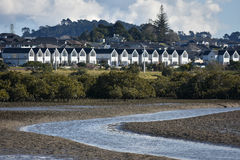 Townhouses at sandy harbour. Tidal area with town houses in the suburbs of Auckland stock photos
