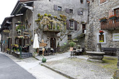 Townhouses and stores in Yvoire. Yvoire, France - May 24, 2013: Townhouses which were built of stone in medieval town are located along a narrow street. In these Stock Photography