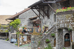 Townhouses by the street in Yvoire. Yvoire, France - May 24, 2013: Townhouses which were built of stone can be seen along the street in medieval town. On a Royalty Free Stock Image