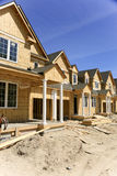 Townhouses Under Construction. This shows townhouses under construction at Wasaga Beach, Ontario, Canada. The framing and siding is complete. The windows, doors Royalty Free Stock Image
