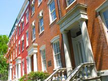 Townhouses on Washington Square, New York City. Red brick Greek Revival townhouses from the 1830's on Washington Square in Greenwich Village, New York City Stock Image