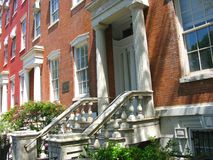 Townhouses on Washington Square, New York City. Red brick Greek Revival townhouses from the 1830's on Washington Square in Greenwich Village, New York City Royalty Free Stock Images