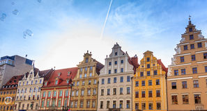 Townhouses in Wrocław. Townhouses in Wroclaw, the main square, old town with floating soap bubbles Stock Image