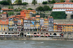 Townscape. In Porto, Portugal. Houses and restaurants by the river Douro royalty free stock photography