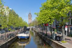 Townscape from the center of Delft, the Netherlands. DELFT, THE NETHERLANDS - APRIL 16:Townscape with unknown people from the center of Delft with a canal and stock photos
