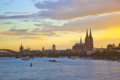 Townscape of Cologne in sunset with Dome and river Rhine Stock Photo