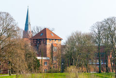 Townscape Nienburg at the river Weser. Townscape Nienburg with church spire and tower Stockturm at the river Weser stock photos