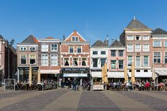 Townscape with people sitting on terraces of Delft, the Netherlands Royalty Free Stock Photo