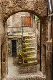 Townscape Scanno, arch, courtyard, stairs. Picturesque Italian town Scanno - arch, courtyard, concrete staircase, flowers Stock Photos
