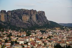 Townscape scenic aerial view of Kalambaka ancient town with beautiful rock formation hill, immense natural boulders pillars. And sky background, Greece Royalty Free Stock Photo