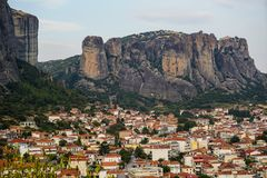 Townscape scenic view of Kalambaka ancient town with beautiful rock formation hill, immense natural boulders pillars and sky. Background, Greece Stock Photo