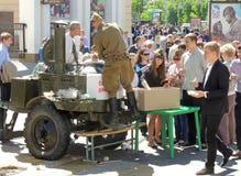 Townsfolk taste army food Stock Photo