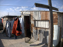Township in South Africa. Corrugated homes in township with clothes hung on washing line, South Africa Royalty Free Stock Photo