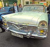 Townspeople around soviet luxury car of 1960-70s GAZ M13 Chaika Royalty Free Stock Photography