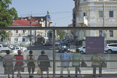 The townspeople at bus stops. The townspeople at the bus stop on the street of Kharkiv.Rear view stock photos