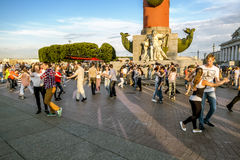 The townspeople are dancing near the Rostral columns. July 5, 2015.Saint-Petersburg.The townspeople are dancing near the Rostral columns in St. Petersburg Royalty Free Stock Images
