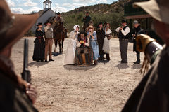 Townspeople Under Attack. From bandits in old west scene Royalty Free Stock Photography