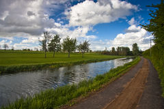 Towpath and golf course by canal Stock Photos