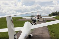 towplane with glider starting royalty free stock photo