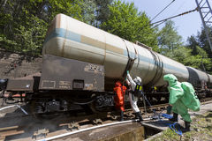 Toxic chemicals acids emergency team near train. A team working with toxic acids and chemicals is securing a chemical cargo train tanks crashed near Sofia Stock Photography