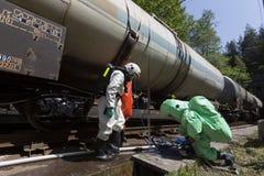 Toxic chemicals acids emergency team train crash Stock Image