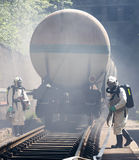 Toxic chemicals acids emergency train firefighters Stock Photography