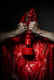 Toxic concept, man with red gas mask. Royalty Free Stock Images