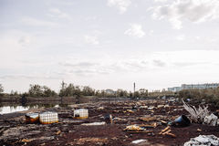 Toxic containers and garbage lying on chemical contaminated wast Stock Photo