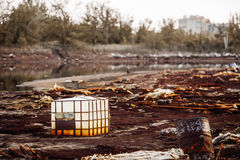 Toxic containers and garbage lying on chemical contaminated wast Royalty Free Stock Photos