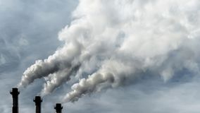 Free Toxic Emissions Of Toxic Gases Into The Atmosphere, Industrial Air Pollution. Dark Chimneys Blowing Huge Billows Of Stock Image - 162269031