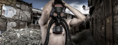 Toxic.Environmental disaster. Post apocalyptic survivor in gas m Stock Image