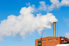 Exhaust smoke and air pollution. Toxic exhaust fumes blown into a sky. Air pollution Stock Images