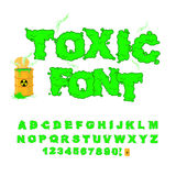 Toxic font. Green alphabet nuclear waste. Venomous acid alphabet. Yellow barrel with sign of radiation. Open container of radioactive waste Royalty Free Stock Photo