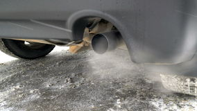 Toxic gases are exhausted on the tailpipe of a car,