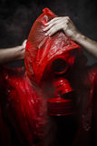 Toxic horror concept, man with red gas mask. Stock Images