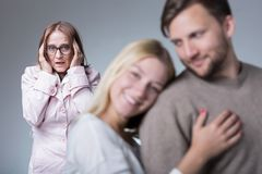Toxic motherly love. Picture of toxic motherly love and oversensitive woman Royalty Free Stock Images
