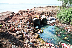Toxic plastic sewer flowing into the sea Stock Photography