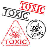 Toxic Rubber Stamps. Toxic skull and bones grungy rubber stamp vector illustrations Royalty Free Stock Photography
