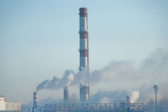 Toxic smoke. From factories on a blue background of the sky stock photo