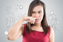 Toxic smoke. A woman in a red dress catches her nose because of a bad smell, Against toxic smoke cartoon background, Poor quality of life in the city, Quality of stock photo