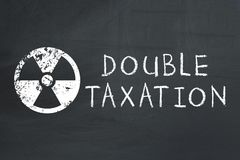 Toxic tax. Double taxation concept. stock photos