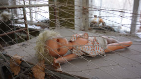 Toxic Toy. A forgotten doll in an abandoned  kindergarten building in the Chernobyl Isolation Zone, Ukraine Stock Images