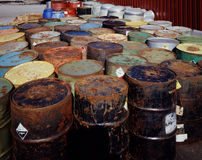 Toxic Waste. Rusting toxic waste drums at storage facility royalty free stock photos