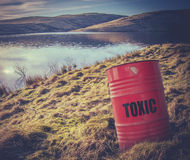 Toxic Waste Near Water. Conceptual Image Of A Toxic Waste Barrel Or Drum Near Water In The Countryside stock photo