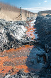 Toxic water. Swag heap in forest (coal mine waste pile) and toxic water Stock Photos