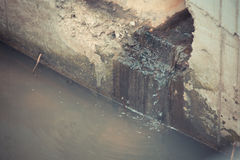 Toxic water running. From sewers required dredging drain tunnel cleaning Royalty Free Stock Image
