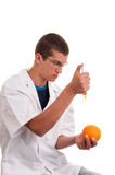 Toxin injection in orange with syringe Stock Images